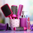 Hair brushes, hairdryer and cosmetic bottles in beauty salo — Stock Photo #21921875