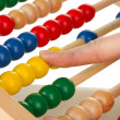Accountant counting on abacus, close up — Stock Photo