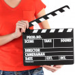 Stock Photo: Movie production clapper board in hands isolated on white