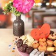 Stock Photo: Sweet cookies with valentine card on plate on table in cafe