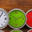 Round office clocks on wooden background — ストック写真