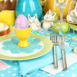 Serving Easter table with tasty dishes close-up - Stock Photo