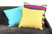 Colorful pillows on couch isolated on white — Stock Photo