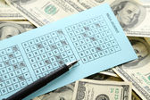 Lottery ticket, money and pen, close up — Stock Photo