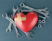 Heart and tools. Concept: Renovation of heart. On color background — Stockfoto