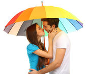 Loving couple standing with umbrella isolated on white — Stock Photo