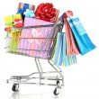 Christmas gifts and shopping in trolley isolated on white — Stock Photo #21988813