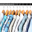 Shirts with ties on wooden hangers on light background — Stock fotografie