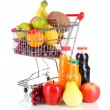 Different fruits in trolley with juice isolated on white — Stock Photo