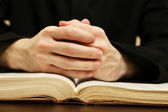 Priest reading from the holy bible, close up — Stock Photo
