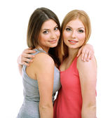 Two girl friends hugging isolated on white — Stock Photo