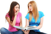 Two girl friends study isolated on white — Stock Photo