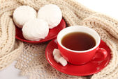 Cup of tea with scarf isolated on white — Stock Photo