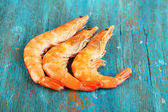 Shrimps on blue wooden table — Stock Photo