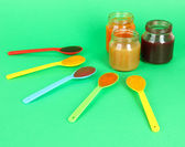 Baby puree on green background — Stock Photo