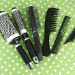 Black combs on color background — Stock Photo #22006387