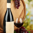 Royalty-Free Stock Photo: Composition of wine, wooden barrel and  grape, on bright background