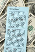 Lottery ticket and money, close up — Stock Photo