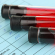 Stock Photo: Blood in test tubes and results close up