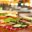 Stock Photo: Tasty sandwiches on table in cafe