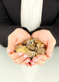 Woman hands with coins isolated on whit — Stock Photo