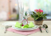 Romantic table serving on bright background — Stock Photo