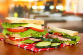 Tasty sandwiches on table in cafe — Stock Photo
