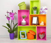 Beautiful colorful shelves with different home related objects — Stock Photo