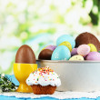 Stock Photo: Composition of Easter and chocolate eggs on wooden table on natural background