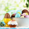Composition of Easter and chocolate eggs on wooden table on natural background — Stock Photo #22081851