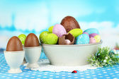 Composition of Easter and chocolate eggs on natural background — Stockfoto