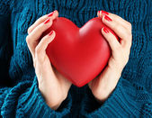 Red heart in woman hands, close up — Stock Photo