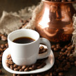 Cup of coffee and pot on wooden background - 图库照片