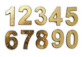 Golden numbers with drops, isolated on white — Stock Photo