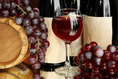 Composition of wine, wooden barrel and grape, on dark red background — Stock Photo