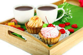 Cups of tea with cakes on wooden tray isolated on white — Stock Photo