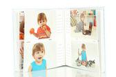 Open baby photo album isolated on white — Stock Photo