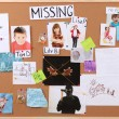 Stock Photo: Board detective to investigate cases of child abduction isolated on white