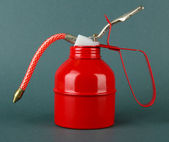 Red oil can, on color background — Stock Photo