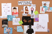 Board detective to investigate cases of child abduction close-up — Stock Photo
