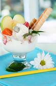 Ice cream with wafer sticks on blue napkin on window background — Stock Photo