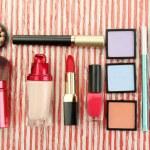 Decorative cosmetics on bright background — Stock Photo #22186571
