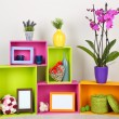 Beautiful colorful shelves with different home related objects — Stock Photo #22188263