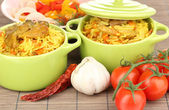 Delicious pilaf with vegetables on table close up — Stock Photo