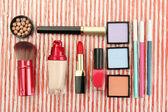 Decorative cosmetics on bright background — Stock Photo