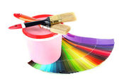 Paint pot, paintbrushes and coloured swatches isolated on white — Stock Photo
