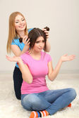 Two girl friends spend their leisure time together on room — Stock Photo