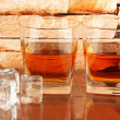 Royalty-Free Stock Photo: Glasses of whiskey and ice on brick wall background