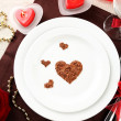 Table setting in honor of Valentine's Day close-up — Stock Photo #22195155