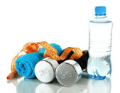 Dumbbells with centimeter,towel and bottle of water isolated on white — Stock Photo